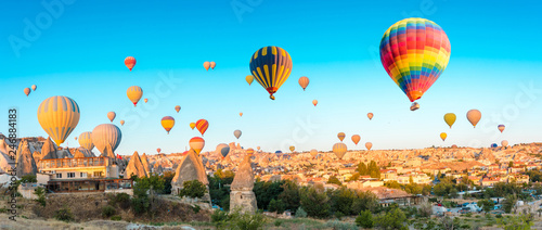 Keuken foto achterwand Ballon Colorful hot air balloons flying over at fairy chimneys in Nevsehir, Goreme, Cappadocia Turkey. Hot air balloon flight at spectacular Cappadocia Turkey.