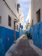 Small cozy streets in blue and white on a sunny day in the old city (medina) Kasbah of the Udayas. UNESCO heritage site. Rabat, Morocco