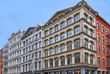 Historic Cast Iron Buildings, Used As Loft Apartments And Shops, Broome Street In SoHo Area Of Manhattan