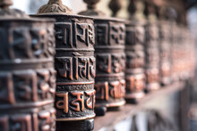 Close-up Of Ancient Prayer Wheel In Buddhist Temple, Kathmandu, Nepal.
