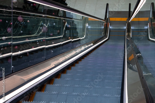 Photo Stands Motor sports Escalator in the mall, top view