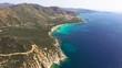 Flying over colorful sardinia mediterranean sea coastline at sunrise