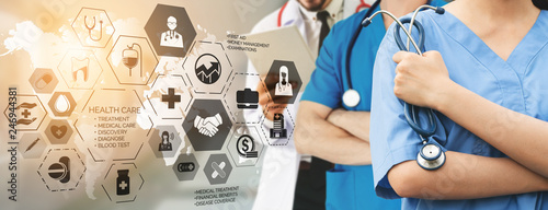 Fotografiet  Health Insurance Concept - Doctor in hospital with health insurance related icon graphic interface showing healthcare people, money planning, risk management, medical treatment and coverage benefit