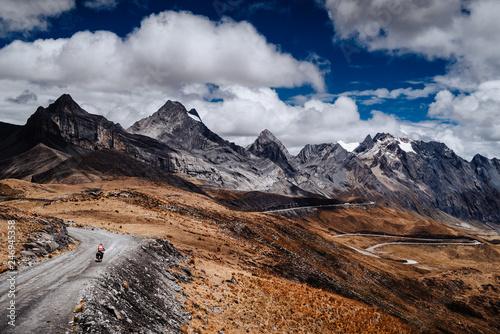 Obraz na plátně A cyclist in Huascaran National Park in Peru