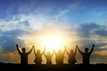 Silhouette Image Of Happy Teamwork Join Hands Together Up To The Beautiful Sky, Successful Business From Good Partnership And Colleagues.