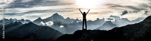 Fototapeta Woman standing at a summit obraz na płótnie