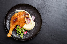Roasted Duck Leg Confit  With Mashed Potatoes And Fresh Salad.