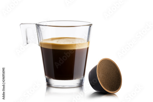 Black coffee in glass cup with coffee waffle on white background