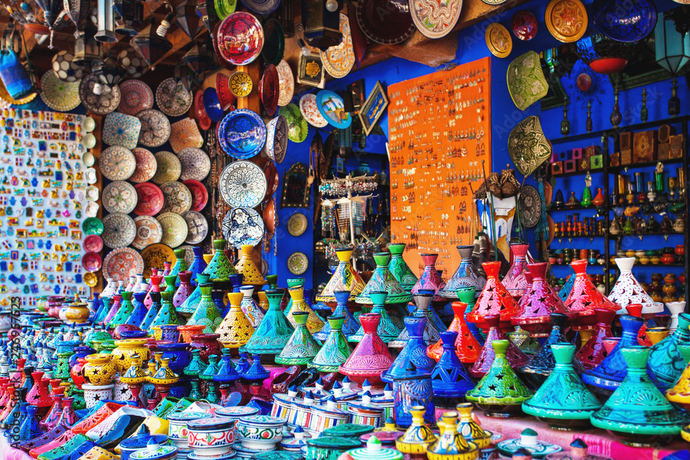 Fototapeta Colored Tajine, plates and pots out of clay on the market in Mor