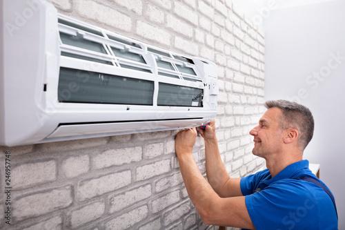 Fotografia, Obraz  Technician Fixing Air Conditioner