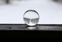 Winter Forest Through A Transparent Glass Ball