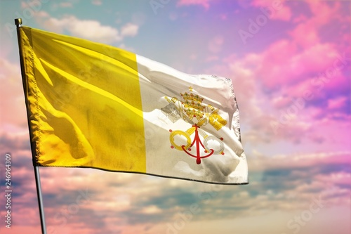 Fényképezés  Fluttering Holy See flag on colorful cloudy sky background