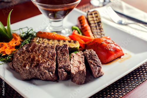 Fototapety, obrazy: Beef steak with grilled vegetables served on white plate. Food concept
