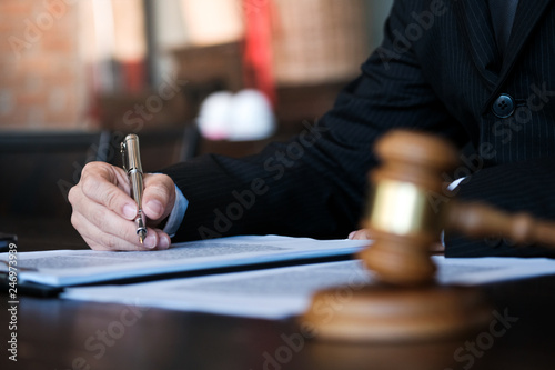 Fototapety, obrazy: Legal counsel presents to the client a signed contract with gavel and legal law. justice and lawyer concept.