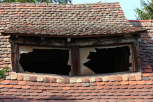 Old House Roof With Brocken Wi...