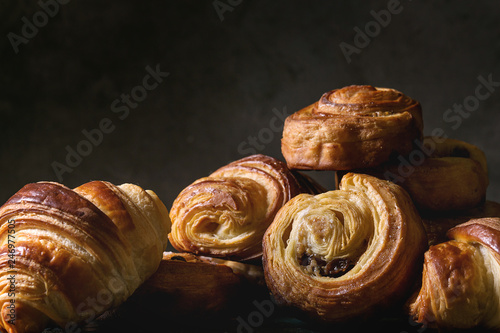 Stampa su Tela Variety of homemade puff pastry buns cinnamon rolls and croissant