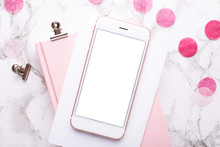 Mobile Phone With A Pink Notebook With Pink Decorations On A Marble Background