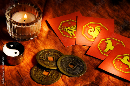 Fotografía  Chinese coins good luck, china astrology signs and candle like Feng Shui, chines