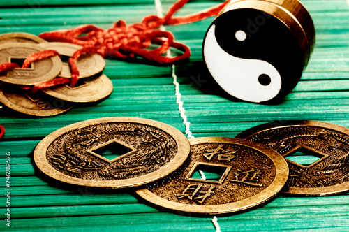 Valokuva chinese good luck coins with yin yang like Feng Shui, I Ching,  and china astrol