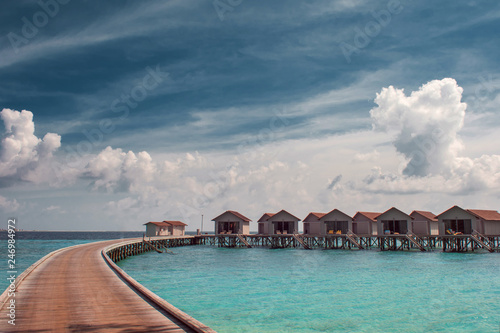 Bungalow on stilts in the water, amazing tropical nature Canvas Print
