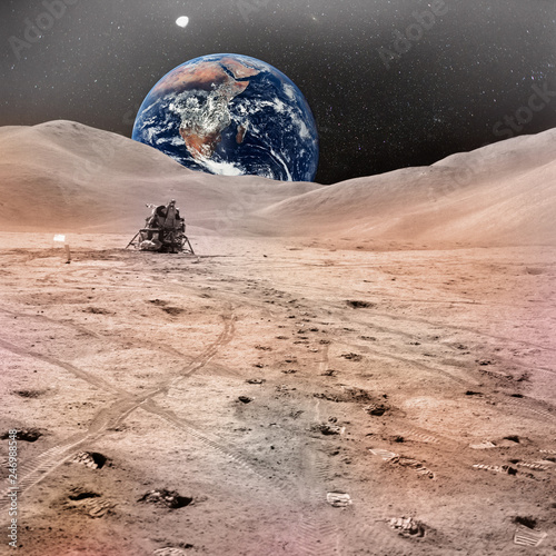 Lunar Module photographed against lunarscape, lunar surface extravehicular, with human footprints and planet Earth in the sky. Elements of this image furnished by NASA.