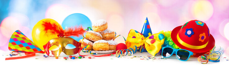Carnival or party with donuts, balloons, streamers and confetti and funny face