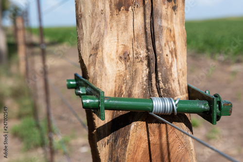 Wiring tensioner in a farm Canvas Print