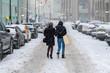 pretty woman walk in city wear warm clothes in winter season b