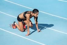 Athlete Woman In Starting Posi...