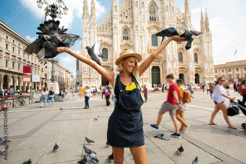 Fotobehang Milan Happy traveler girl in Milan city. Tourist woman posing with pigeons near Duomo cathedral in Milan, Italy, Europe