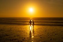 Silhouettes At Sun Set On The Main Beach Of Agadir