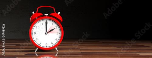European daylight saving time. Red alarm clock on wooden desk, black background, banner. 3d illustration