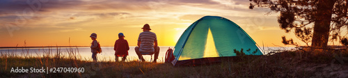 Poster de jardin Camping Family resting with tent in nature at sunset
