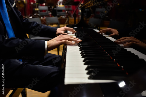Fotografie, Obraz  Professional pianist performing a piece on a grand piano.