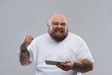 Happy Bearded Man Clenching Hi...