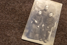 Portrait Of Farmers Family In Period Of World War I On Trench Coat Background