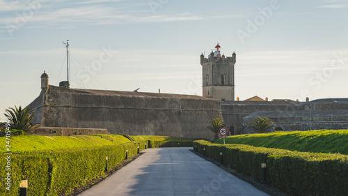 Poster Con. Antique Saint Julian Fortress entrance with green garden, Oeiras, Lisbon