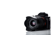 Mirrorless Digital Camera With Telephoto Zoom Lens Isolated On White Background With Reflections On The Lens