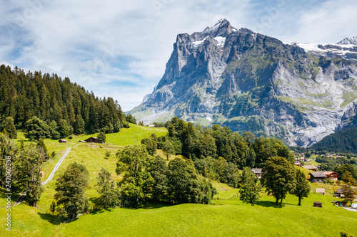 Sunny view of alpine Eiger village. Location place Swiss alps, Grindelwald valley.