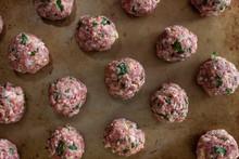 Raw Meatballs On A Sheet Pan