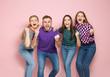 Leinwandbild Motiv Young people celebrating victory on color background
