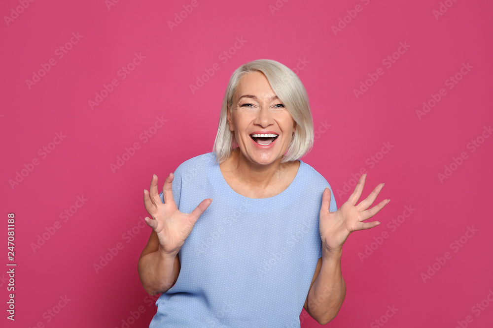 Fototapety, obrazy: Portrait of mature woman laughing on color background