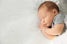 Adorable Newborn Baby Peacefully Sleeping On Bed, Top View With Space For Text