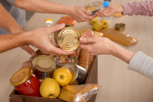 Volunteers Taking Food Out Of ...