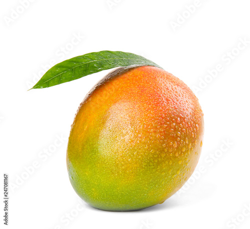 Delicious ripe mango on white background. Tropical fruit