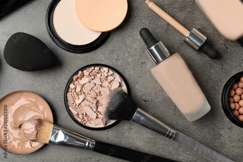 Fototapeta Flat lay composition with skin foundation, powder and beauty accessories on grey background