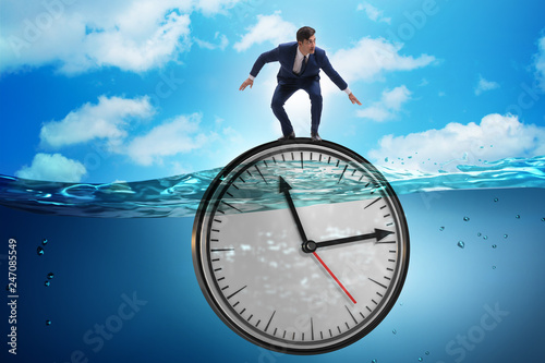 Obraz Businessman in deadline and time management concept - fototapety do salonu