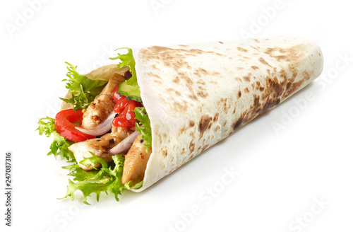Photo Tortilla wrap with fried chicken meat and vegetables