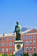 Wolfgang Amadeus Mozart Monument Statue On Mozart Square Mozartplatz Located At Salzburg, Austria. Beautiful Summer Day. Mozart Was A World Famous Influential Austrian Composer Of The Classical Era.