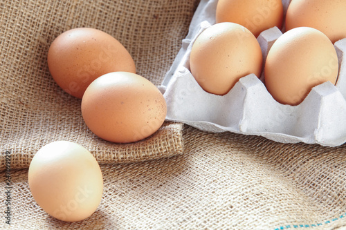 Pile of Brown fresh egg on brown fabric